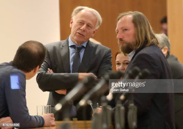German Greens Party members Juergen Trittin and Anton Hofreiter chat during preliminary coalition talks at the BadenWuerttemberg state representation...