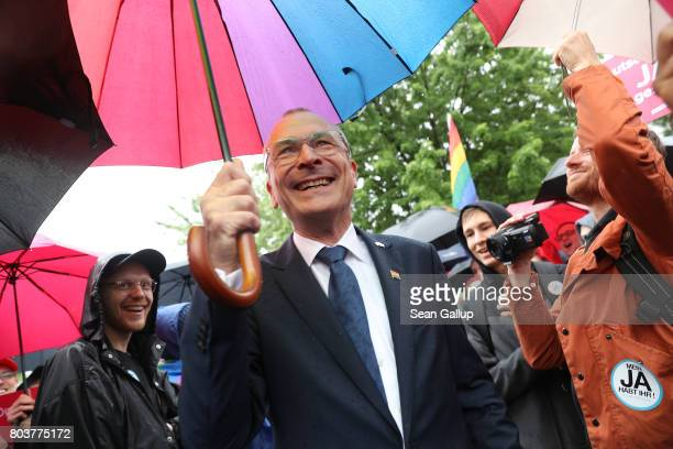 German Greens Party parliamentarian Volker Beck joins supporters of gay rights gathered outside the Chancellery to celebrate following a vote at the...