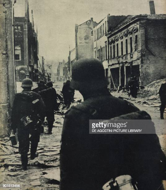 German grenadiers combatting in the ruins of Jelgava Latvia World War II photograph by Atlantic from L'Illustrazione Italiana Year LXXI No 40 October...