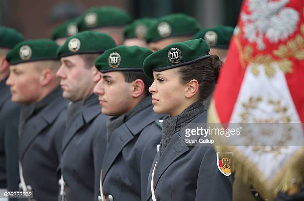 German guard of honour including a female Bundeswehr soldier waits for the arrival of Polish President Andrzej Duda and German President Joachim...
