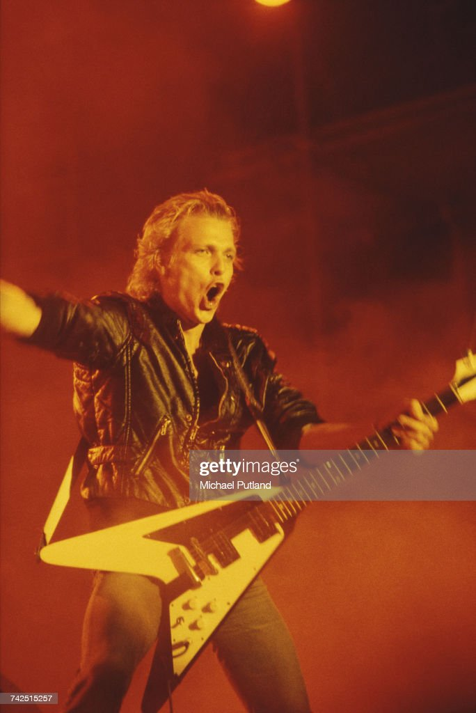 German guitarist Michael Schenker performs live on stage, playing a Gibson Flying V guitar, with the Michael Schenker Group at the Reading Festival, near Reading, England on 29th August 1982.