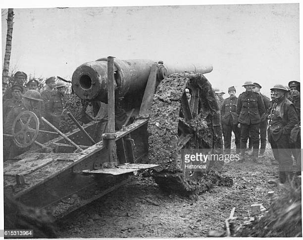 A German gun captured during the Cambrai offensive dwarfs people standing next to it September 19 1917 | Location Ribecourt France