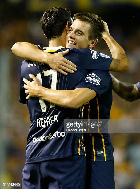 German Gustavo Herrera of Rosario Central celebrates with teammates after scoring their team's second goal during a match between Rosario Central and...