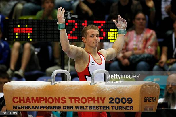 German gymnast Fabian Hambuechen celebrates after his performance at the pommel horse in the German allaround championship during the German...