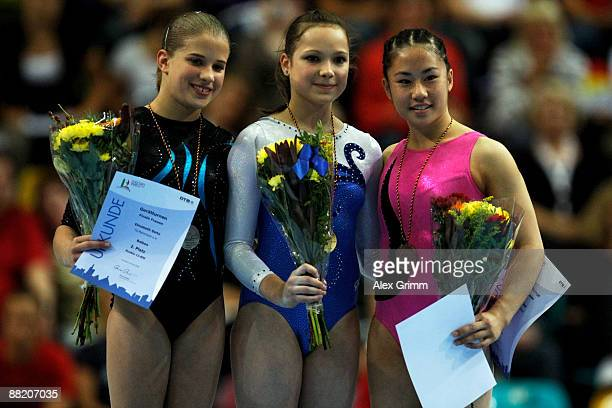 German gymnast Joeline Moebius poses with Elisabeth Seitz and Kim Bui after winning the balance beam competition in the German individual...