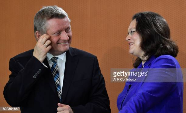 German Health Minister Hermann Groehe and German Labour and Social Minister Andrea Nahles talk prior to the weekly cabinet meeting at the Chancellery...