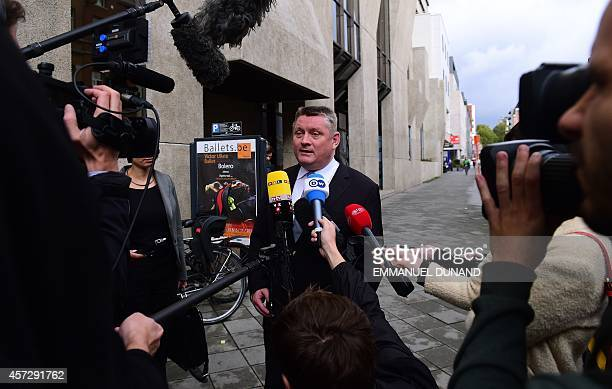 German Health Minister Hermann Grohe speaks to journalists as he arrives to attend a ministerial meeting on EU public health measures on the Ebola...