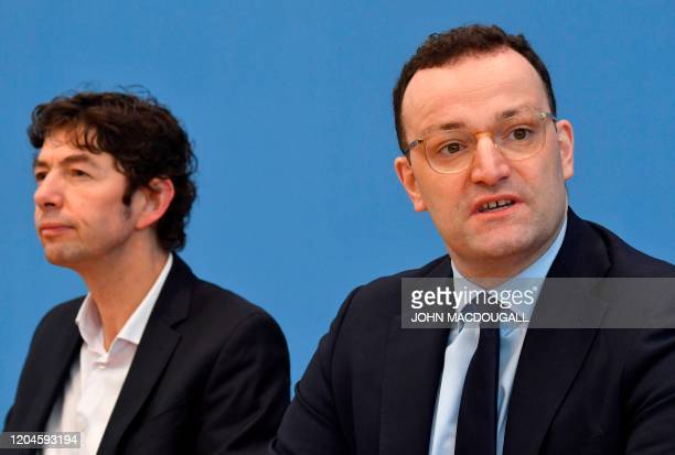 German Health Minister Jens Spahn and Christian Drosten director of the Institute of Virology at Berlin's Charite hospital address a press conference...