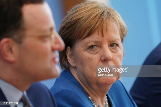 German Health Minister Jens Spahn and German Chancellor Angela Merkel speak to the media over the ongoing coronavirus spread in Europe on March 11...
