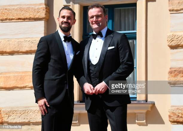 German Health Minister Jens Spahn and his husband Daniel Funke arrive for the opening ceremony of the annual Bayreuth Festival featuring the music of...