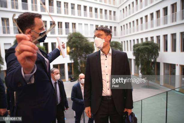 German Health Minister Jens Spahn and Karl Lauterbach, health policy expert of the German Social Democrats , arrive to speak to the media the day...