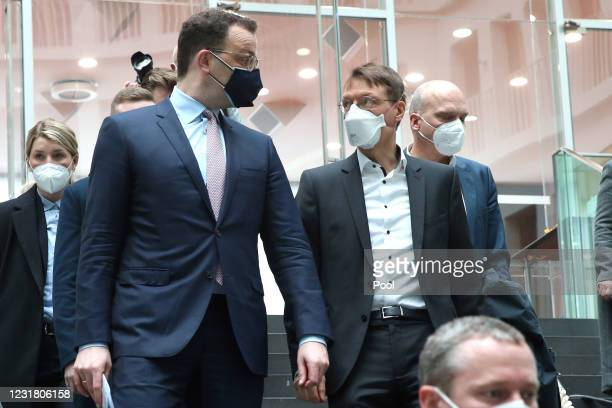 German Health Minister Jens Spahn and Karl Lauterbach, health policy expert of the German Social Democrats , leave after a press conference the day...