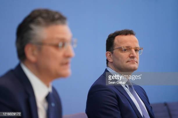 German Health Minister Jens Spahn and Robert Koch Institute President Lothar Wieler speak to the media during the coronavirus crisis on April 17 2020...