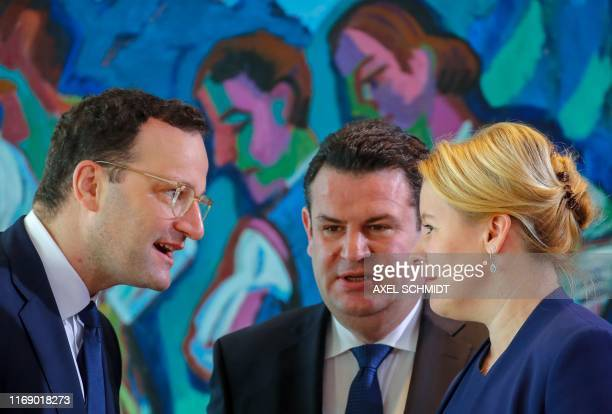 German Health Minister Jens Spahn confers with German Labour Minister Hubertus Heil and German Family Minister Franziska Giffey prior the start of...