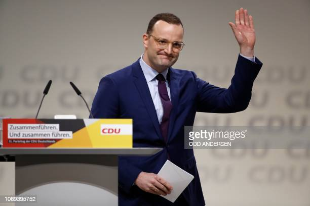 German Health Minister Jens Spahn one of the top candidates for the CDU party's leadership waves after delivering a speech at a party congress of...