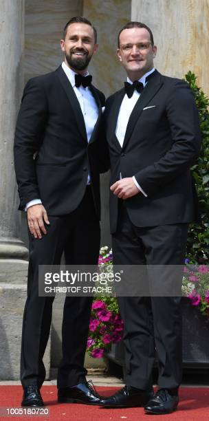 German Health Minister Jens Spahn poses with his husband Daniel Funke as they arrive for the opening of the annual Bayreuth Festival featuring the...