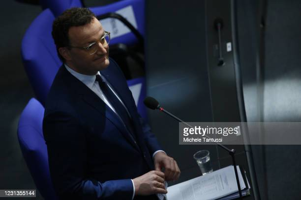 German Health Minister Jens Spahn reacts as he speaks during a question and answer session at the Bundestag during the coronavirus pandemic on...