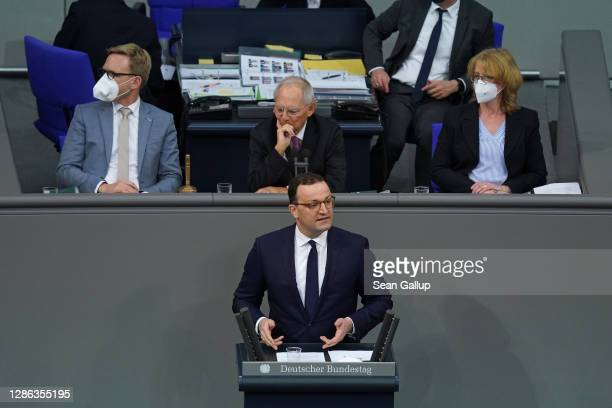 German Health Minister Jens Spahn speaks during debates at the Bundestag on modifications to a law called the infection protection law during the...