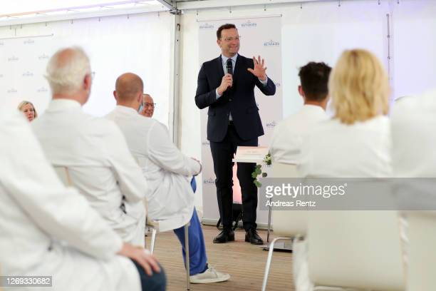 German Health Minister Jens Spahn speaks to medical personel after visiting a tent used for coronavirus testing together with North RhineWestphalia...