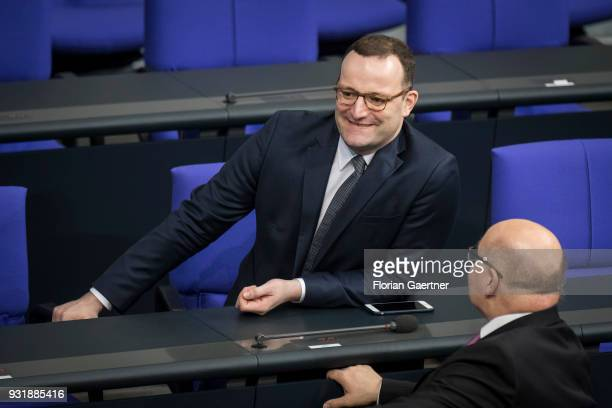 German Health Minister Jens Spahn talks with German Economy Minister Peter Altmaier before the swearingin ceremony of the new federal government on...