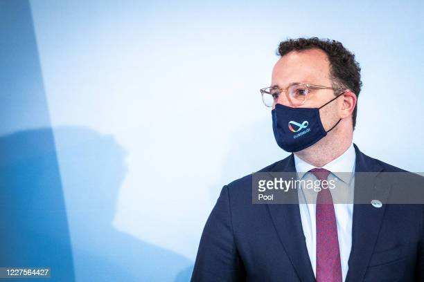 German Health Minister Jens Spahn wears a face masks as he attends an informal meeting of European Union member states health ministers via video...
