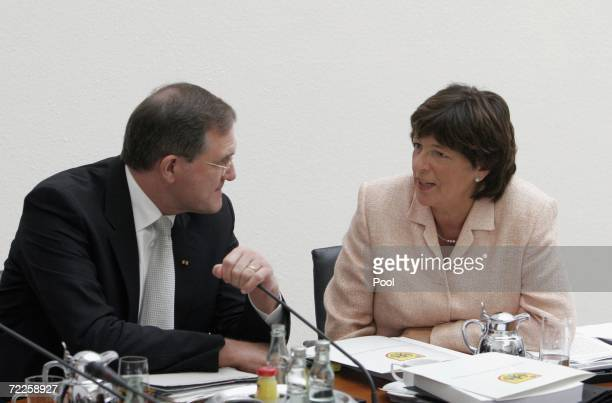 German Health Minister Ulla Schmidt and German Defence Minister Franz Josef Jung attend the weekly government cabinet meeting at the Chancellery on...