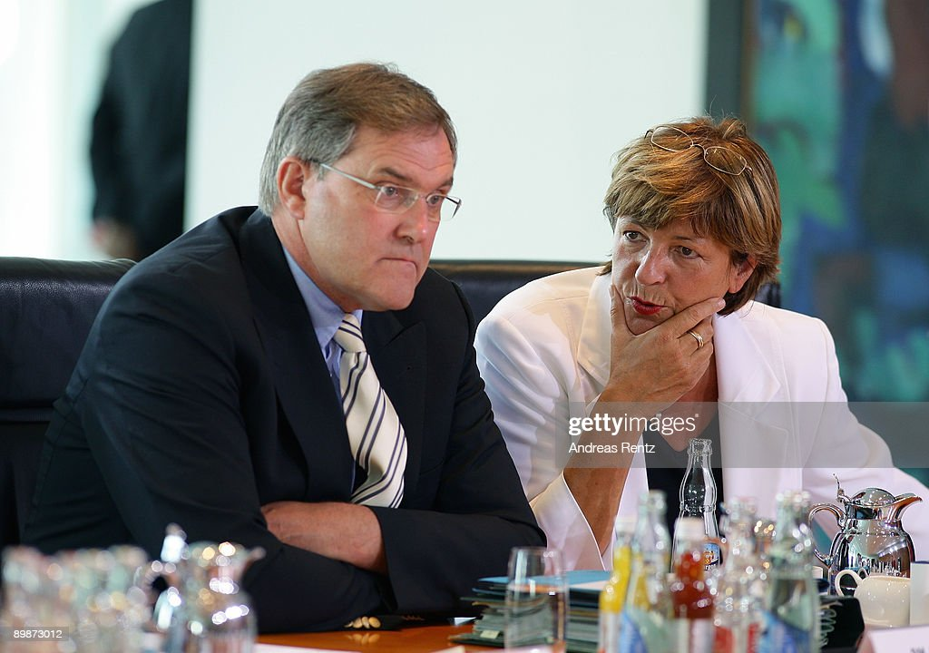 German Health Minister Ulla Schmidt talks to German Defense Minister Franz Josef Jung prior to the weekly German government cabinet meeting at the Chancellery on August 19, 2009 in Berlin, Germany. High on the morning's agenda was the obligation of the statutory health insurance of the new vaccinations against influenza A(H1N1), so called swine flu.