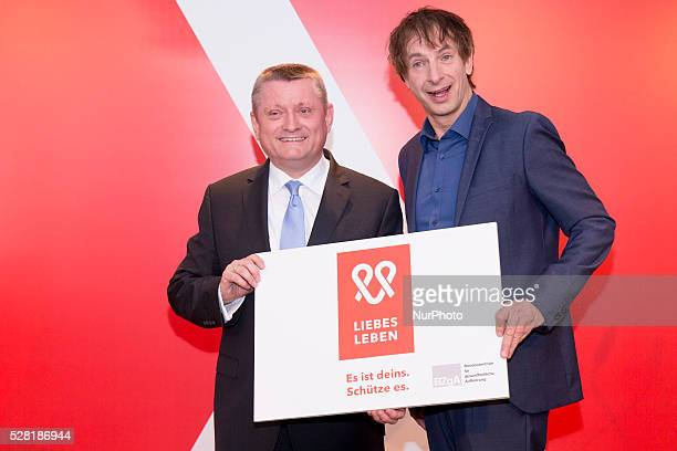 German Heath Minister Hermann Groehe and actor Ingolf Lueck hold a banner with the logo 'liebesleben' during the launch of a new sensibilisation...