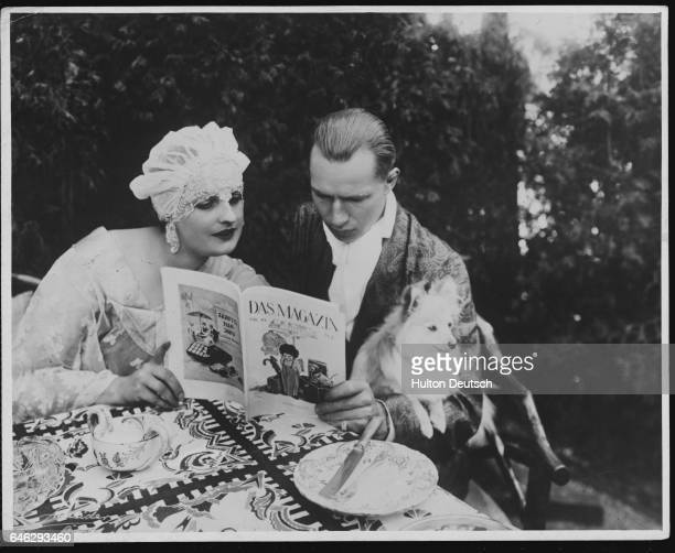 German heavyweight boxing champion Kurt Prenzil and his wife silent film star Baroness Fern Andra read a magazine together at their home in Berlin