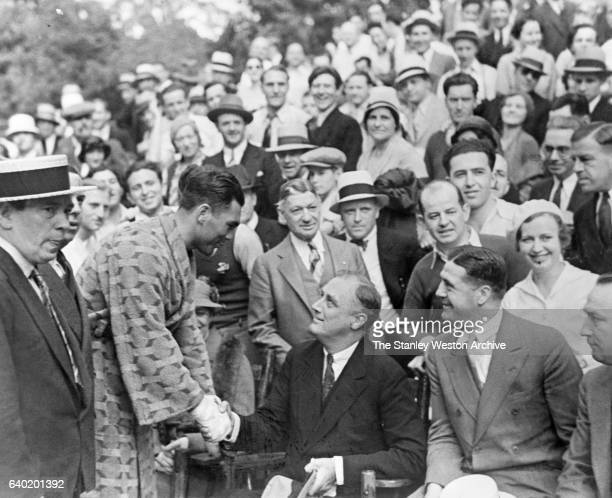 German Heavyweight Max Schmeling shakes hands with Gov Franklin D Roosevelt after the governor watched him training for his coming title fight with...