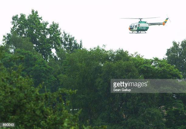 German helicopter searches a forest near the wreckage of a Tupelov154 Russian passenger airliner July 2 2002 near the town of Ueberlingen Germany The...