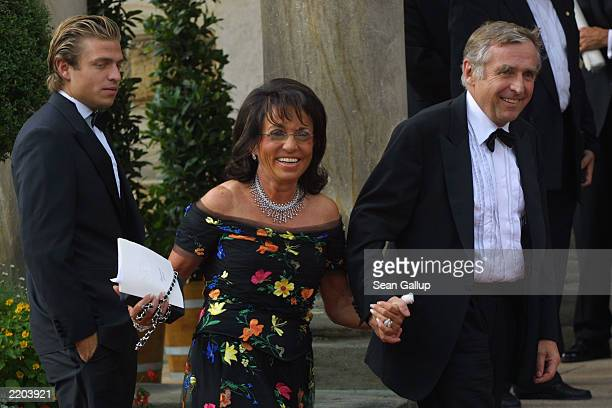 German highsociety figure Regine Sixt arrives with her husband Erich head of the Sixt car rental agency and one of her sons at the opening day of the...