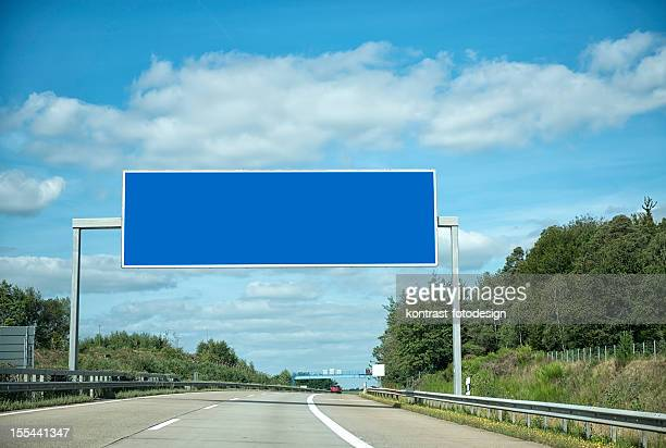 german highway under cloudscape - road sign stock pictures, royalty-free photos & images