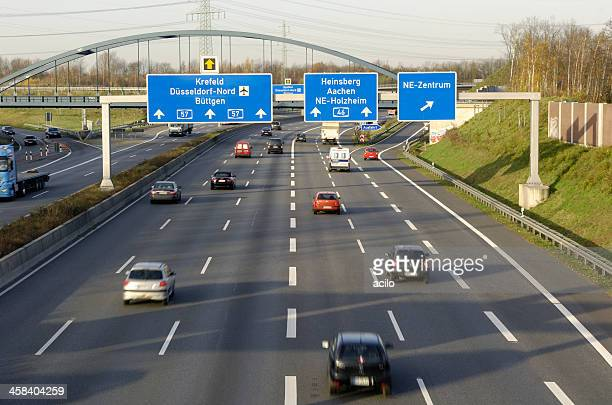 german highway with overhead signs - düsseldorf stock pictures, royalty-free photos & images