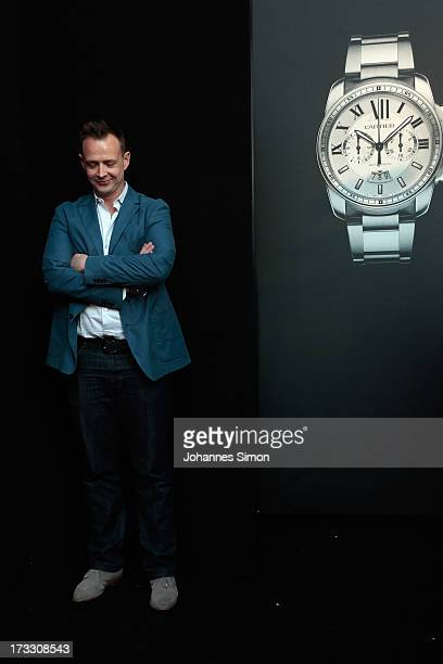 German Holger Stromberg arrives for the 'League of Gentlemen' launch of the Calibre de Cartier chronograph at Heart Club on July 11 2013 in Munich...
