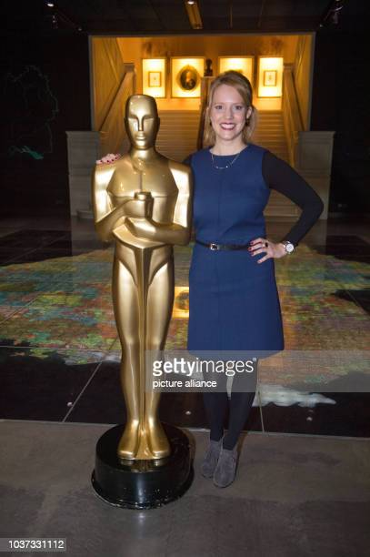 German Hollywood actress Nina Rausch poses with an oversized Oscar statue during a press call for the Carl Laemmle exhibition at the Haus der...