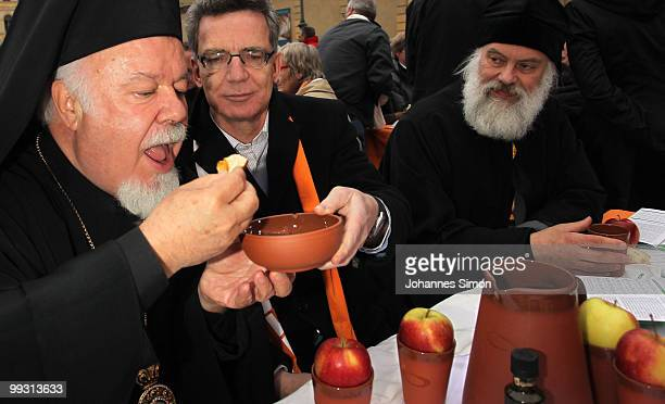 German home secretary Thomas de Maiziere participates in the celebration of Greek orthodox vespers during day 3 of the 2nd Ecumenical Church Day at...