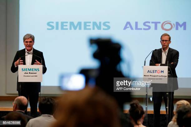 German ICE train manufacturing company Siemens President and CEO Joe Kaeser and French railway transport company Alstom CEO Henri PoupartLafarge...