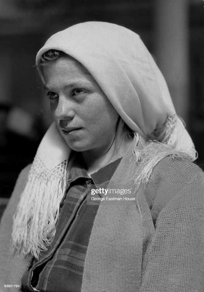 A German immigrant girl waits to be processed at Ellis Island in New York, 1926.