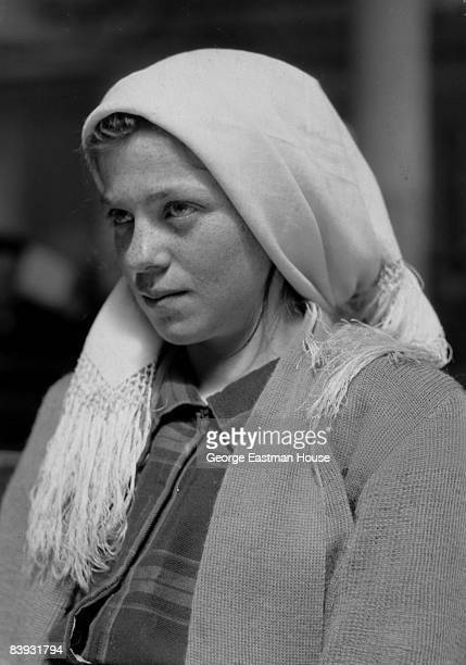 A German immigrant girl waits to be processed at Ellis Island in New York 1926