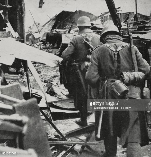 German infantry progressing through the rubble in Stalingrad Russia World War II from L'Illustrazione Italiana Year LXIX No 43 October 25 1942