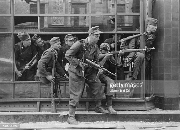 German infantrymen who were participating in the abolition of the Warsaw uprising August 1944