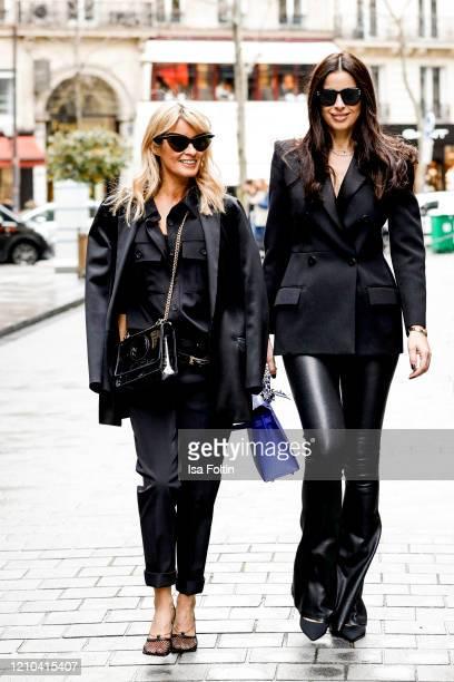German influencer Gitta Banko, wearing a black blouse by Frankie Shop, black pants by Sly010, a double belt, a black silk oversized blazer and a...