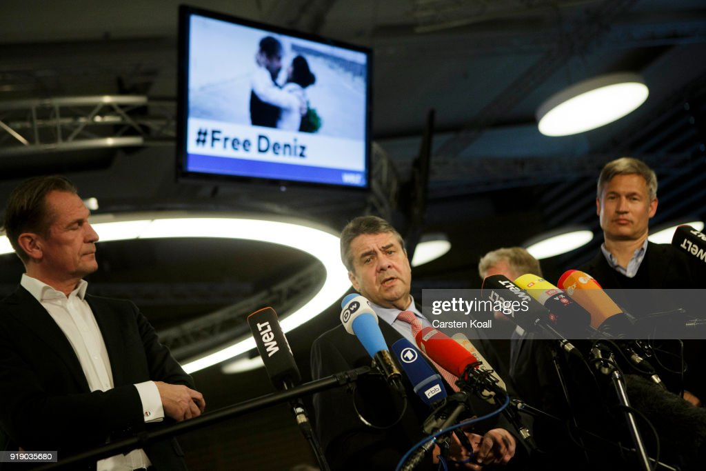 German Interim Foreign Minister Sigmar Gabriel (C), Axel Springer Verlag Chairman Matthias Doepfner (L) and Die Welt Editor-In-Chief Ulf Poschardt (R) speak to the media in the Die Welt newsroom following the release of Die Welt journalist Deniz Yucel from a Turkish prison earlier today on February 16, 2018 in Berlin, Germany. Yucel spent a year in Turkish prison after Turkish authorities accused him of supporting terrorism. His release today comes after long-running talks between the German and Turkish governments, though it is unclear what his fate will be. According to media reports Turkish authorities are not prohibiting Yucel from leaving the country, yet his release comes after a Turkish prosecutor demanded an 18-year-sentence. (Photo by Carsten Koall/Getty Images))