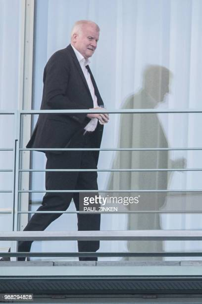 German Interior Minister and Bavarian Christian Social Union politician Horst Seehofer follows the German Chancellor and leader of the Christian...