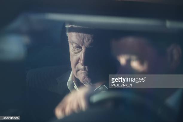 German Interior Minister and Bavarian Christian Social Union politician Horst Seehofer arrives in a car at the Chancellery for talks with the German...
