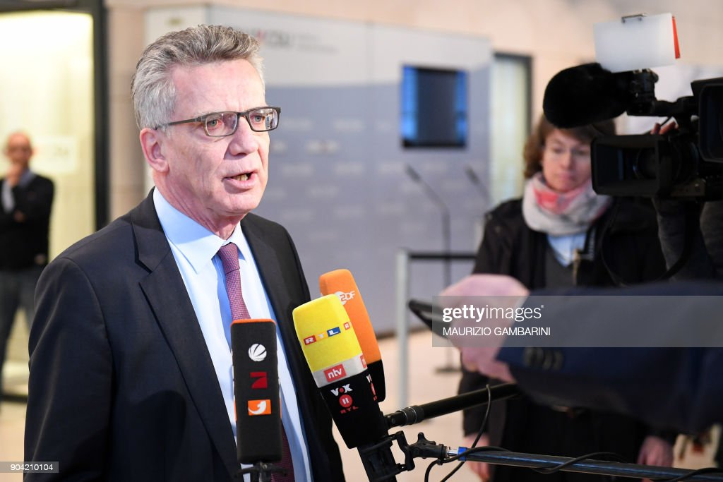 German Interior Minister and CDU politician Thomas de Maiziere talks to the press as he arrives for a parliamentary group meeting of the Christian Democratic Party (CDU) and the Christian Social Union (CSU) faction at the Reichstag parliament building in Berlin. / AFP PHOTO / dpa / Maurizio Gambarini / Germany OUT