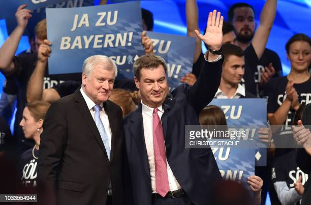 German Interior Minister and leader of the Bavarian Christian Social Union Horst Seehofer and Bavaria's State Premier and top candidate of the...