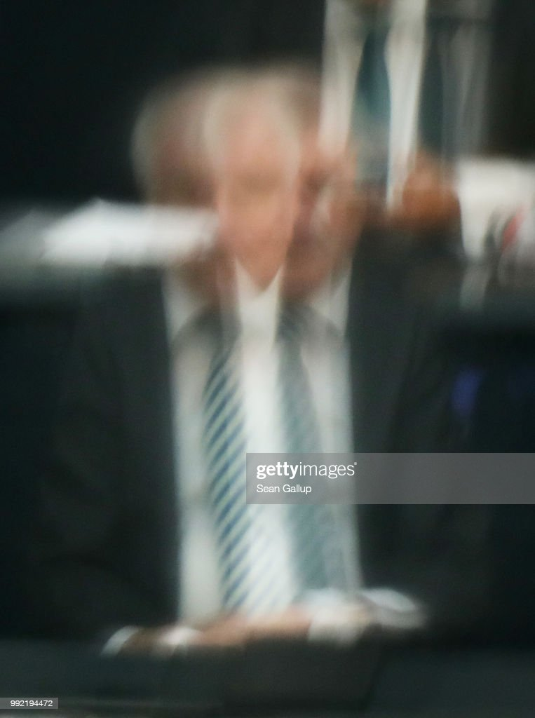 German Interior Minister and leader of the Bavarian Social Union (CSU), Horst Seehofer, is seen through two sections of glass as he attends debates at the last session of the Bundestag before the sumer break on July 5, 2018 in Berlin, Germany. Seehofer and German Chancellor and leader of the German Christian Democratic Union (CDU) Angela Merkel recently reached a hard-wrung compromise over migration policy, though uncertainty remains over how the compromise will be implemented.