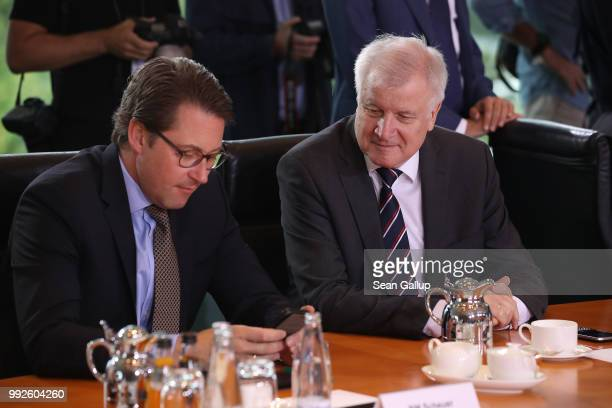 German Interior Minister and leader of the Bavarian Social Union Horst Seehofer and Transport and Digital Infrastructure Minister Andreas Scheuer...